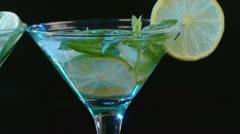 Martini cocktail with lime and mint - stock footage