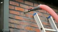 Injecting insulation into a cavity wall Stock Footage