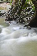 part of a waterfall taken with a slow shutter speed to smooth the water - stock photo