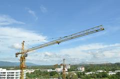 crane and building working progress, construction site - stock photo