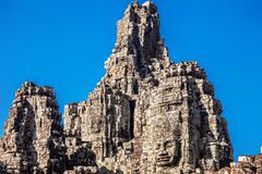 Stock Photo of faces of ancient bayon temple at angkor wat