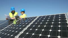 engineers working on solar panels plant - stock footage