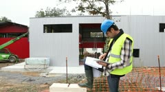 construction manager using electronic tablet on site - stock footage