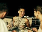 Group of friends celebrating dinner on the terrace at night, steadycam shot Stock Footage