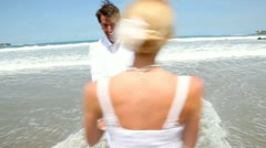 Married couple on a paradisiacal beach Stock Footage