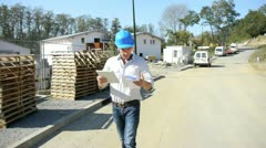 Construction manager using electronic tablet on building site Stock Footage