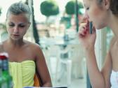Female friends reading menu in the restaurant, steadicam shot Stock Footage