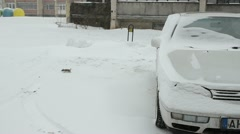 Blizzard snow fall car standing block flat house outdoor parking Stock Footage