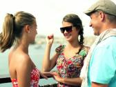 Portrait of smiling friends standing in the city, steadycam shot Stock Footage