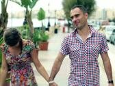 Happy couple walking on the street, slow motion Stock Footage
