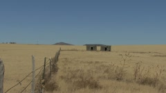 New Mexico fence and shack on plain 1 Stock Footage