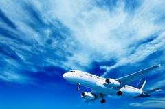 Aircraft on a cloudy sky background Stock Illustration