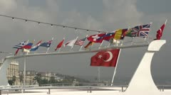 Nations flags on yacht in harbor, Turkey, Greece, US, British, etc Stock Footage