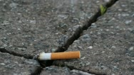Stock Video Footage of Cigarette on pavement