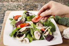 preparing fresh salad for dinner - stock photo