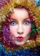 Woman in tinsel christmas costume Stock Photos