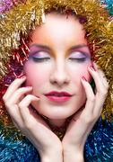 woman in tinsel christmas costume - stock photo
