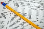 Chewed pencil on tax form Stock Photos