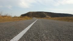 Country road with tumbleweed Stock Footage