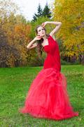 A beautiful brunette in red dress Stock Photos