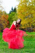 a beautiful brunette in red dress - stock photo
