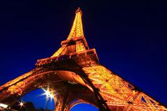 paris - apr 20: eiffel tower light performance show in dusk with the moonon a - stock photo