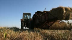Old Tractor baler machine in the field of Ukraine - stock footage