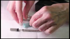 Acupuncture (medicine): demonstration of Su Jok needles and inserter. Stock Footage