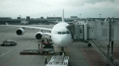 Airplane parked at the gate in the airport Stock Footage