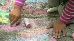 Child Painting with Colorful Chalk on the Pavement Stock Footage