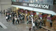 Arriving passenger check point Singapore Changi airport Stock Footage