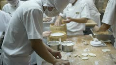 Asian chef making dumplings from flour Stock Footage