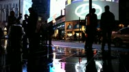 Stock Video Footage of Piccadilly Circus on a wet night with people and traffic (2)