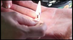 Acupuncture medicine, Su Jok Therapy - Moxa fumes away on a hand. Stock Footage