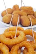spanish croquettes and calamares a la romana, squid rings - stock photo