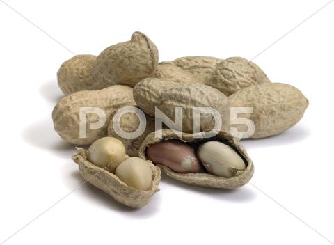 Stock photo of half peeled peanut