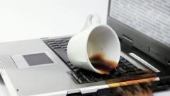 Coffee spilled over working notebook Stock Footage