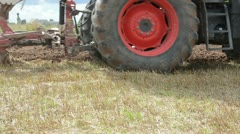 Stock Video Footage of closeup of tractor wheel and plough plow agriculture field soil