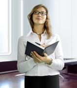 Business woman with notebook Stock Photos