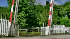 Level crossing gates drop into closed position Stock Footage