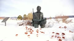 Statue of fallen soldier in snow time-lapse Stock Footage
