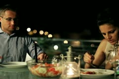 Happy family celebrating dinner on the terrace at night, steadycam shot Stock Footage