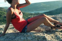 Happy woman relaxing near the vantage point, crane shot Stock Footage