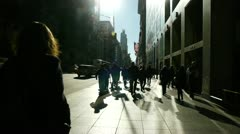 Crowd of people walking backlight in New York City slow motion Stock Footage