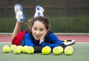 Stock Photo of outdoor tennis fun for girl