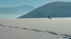 Ice fisherman returns Stock Footage