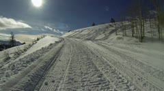 Snowmobile climbing steep winter mountain HD 1004 Stock Footage