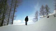Man walking alone in the snow - stock footage