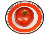 One red tomato Stock Photos