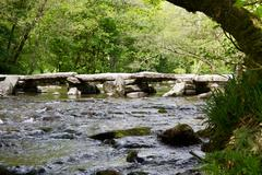 Tarr Steps ancient bridge tourist attraxction Exmoor England - stock photo